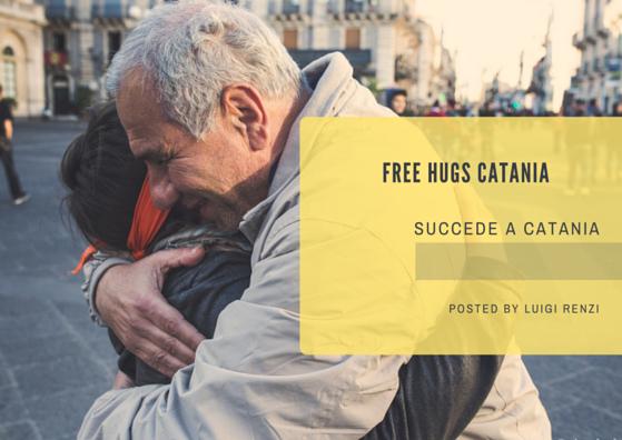 un abbraccio nella piazza università di Catania, Sicilia durante il giorno free hugs