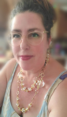 E.K. wearing our Clear resin nugget/rock long necklace