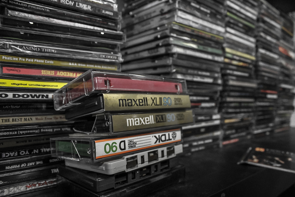 cds tapes cassettes piles of stuff