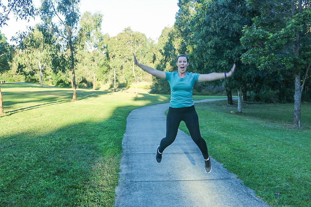 woman jumping for joy full of energy