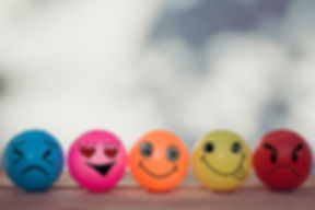 Smiley balls and Emotion balls on wooden table with bokeh wall background and copy space.jpg