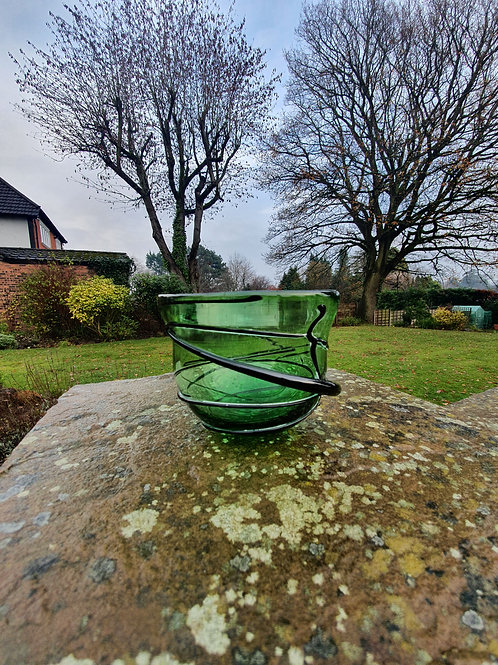 Green vessel with black trail