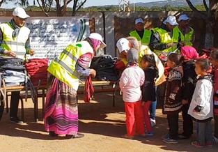 Distribution de cartables et fournitures scolaires