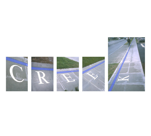 Cast aluminum letters and a blue line become a life-sized map superimposed on the site itself.