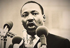 Martin Luther King speaking into microphone