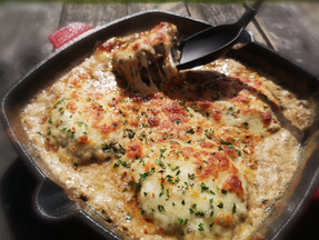 Baked beef burgers in mushrooms and cheese