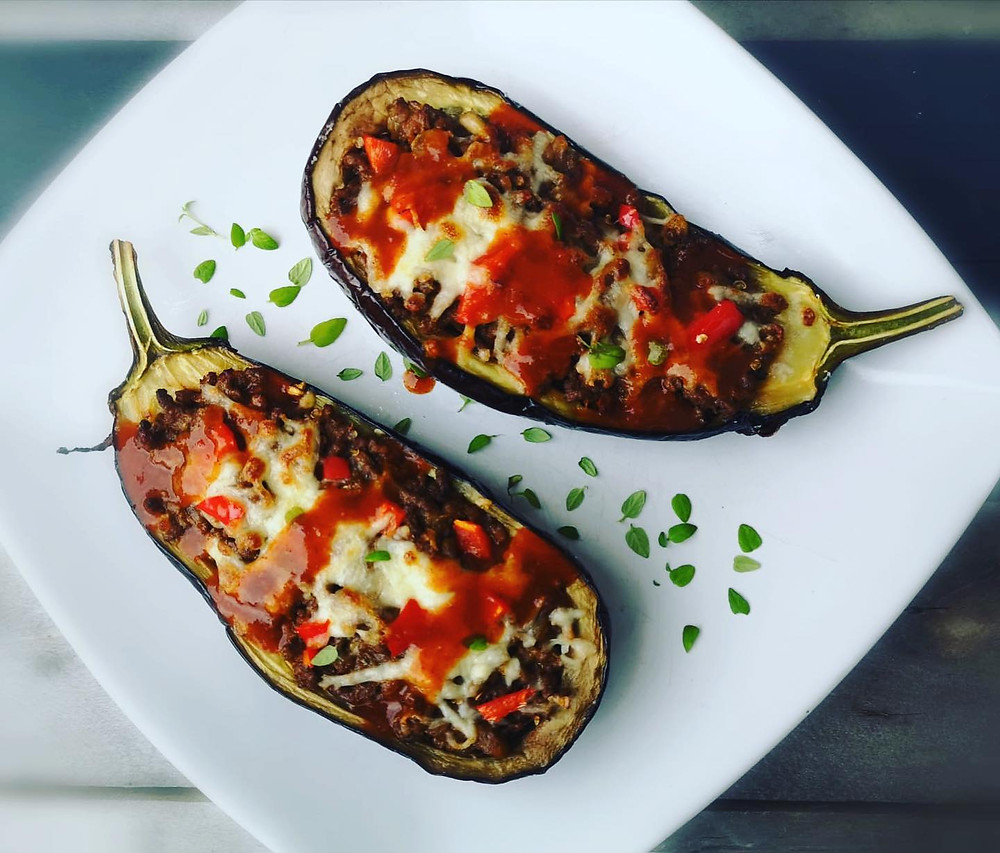 Keto stuffed eggplant aka aubergine stuffed with minced beef and topped with melted cheese