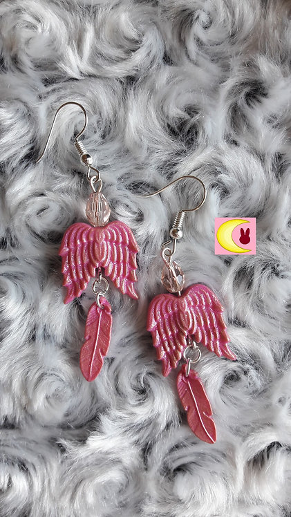 Boucles d'oreilles Plum Wing Ailes d'ange rose pailleté avec plume en porcelaine