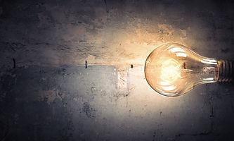 Light bulb on stone surface.jpg