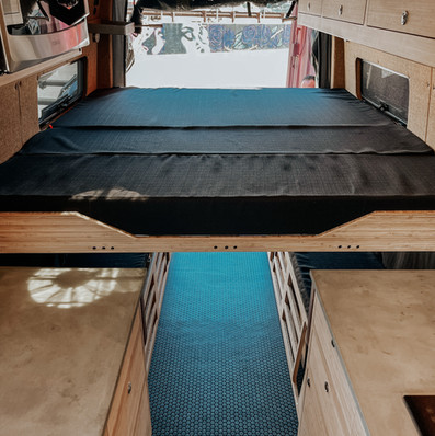 bed in a camper van.JPG