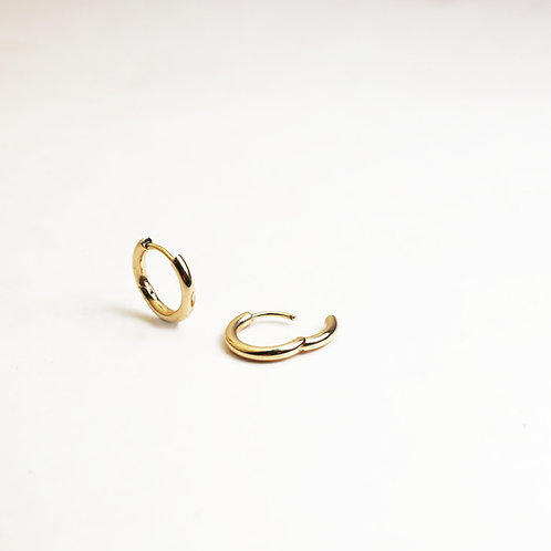A pair of solid 9ct gold huggies