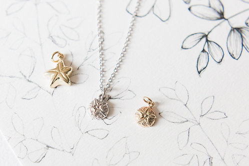 Ocean inspired gold charms and pendants