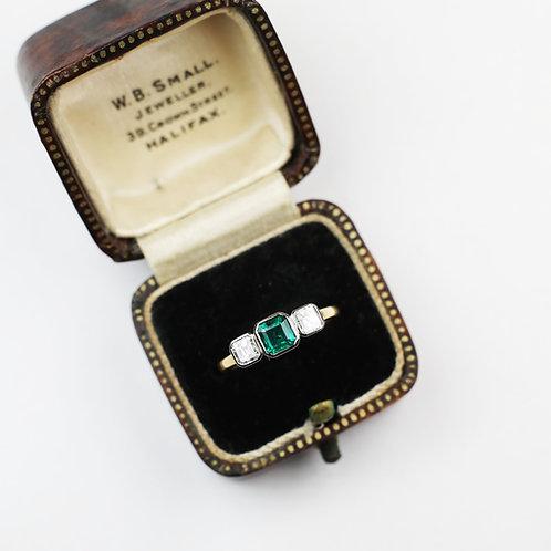 An Art Deco Inspired Emerald and Asscher cut Diamond ring