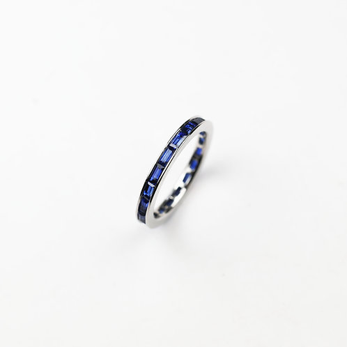 A sapphire and platinum eternity ring