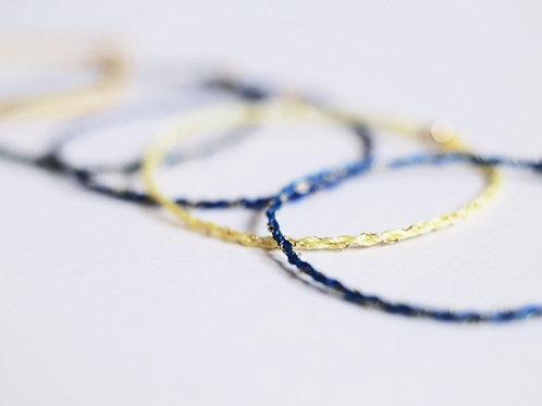 Skinny gold and silk bracelets