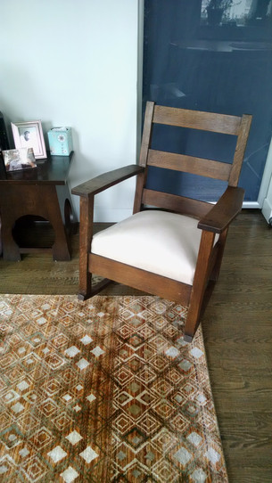 Restored and reupholstered Mission-style rocking chair.