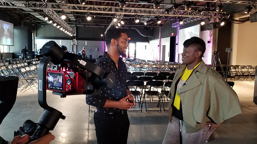 Jeremy Turner interviewing Korto Momolu at the NWA Fashion Week