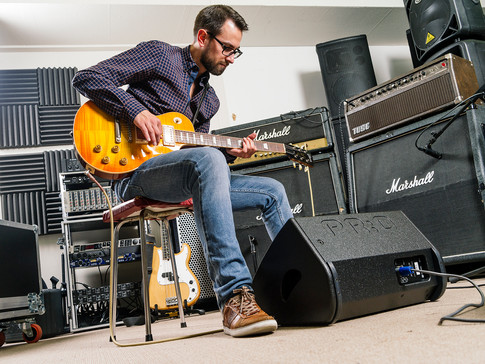 Simon recording guitar tracks