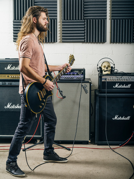 Christian recording guitar tracks