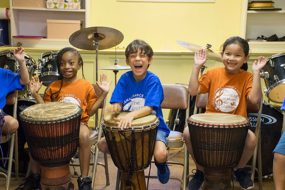 Students in an Institute of Music for Children African drumming class.