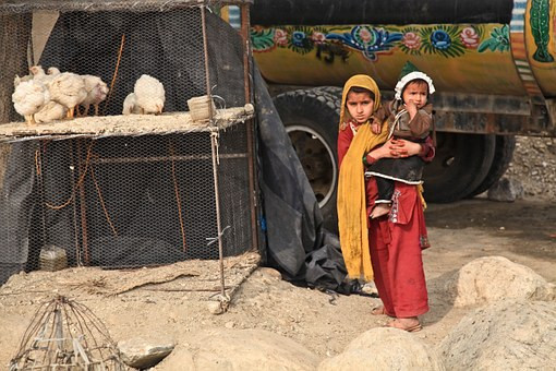 afghan children painted lorry hens cage gilr baby