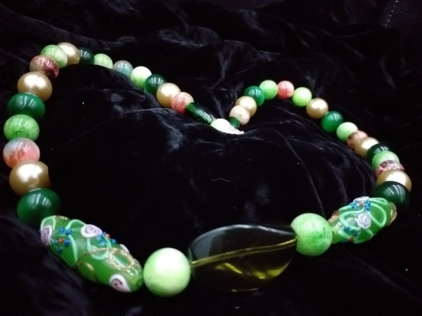 Beautiful green necklace centred round Chinese patterned glass beads
