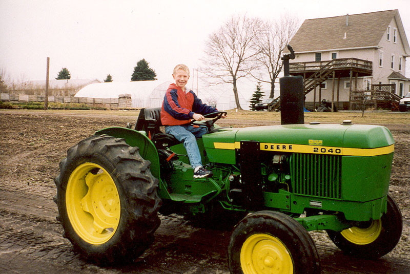 Lewis Mason on a Tractor