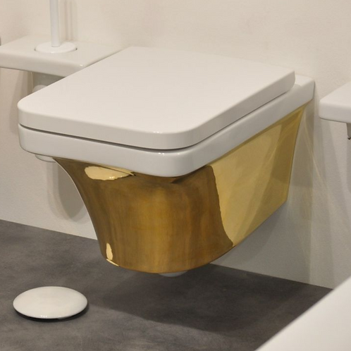 Flat white/gold wall hung WC