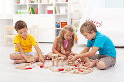2119275-three-kids-playing-with-wooden-blocks