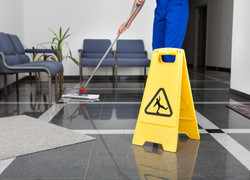 6414236-man-with-mop-and-wet-floor-sign