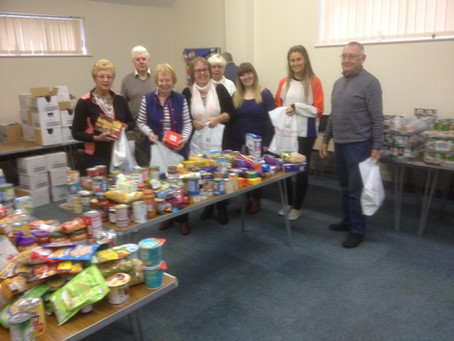 Rotary wrap their Christmas parcels at Wesley