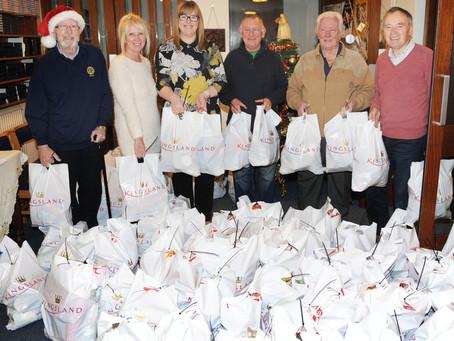 Rotary club wrap their Christmas parcels