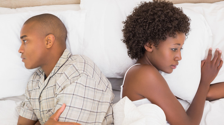 bigstock-Unhappy-couple-lying-on-bed-no-