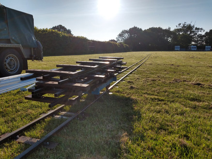 Ready in the early morning sun to lay the track.