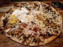 Pizza w/ brussel sprouts,caramelized onions,shaved parmesan & an egg on top