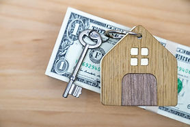 cash behind a house to show investing returns