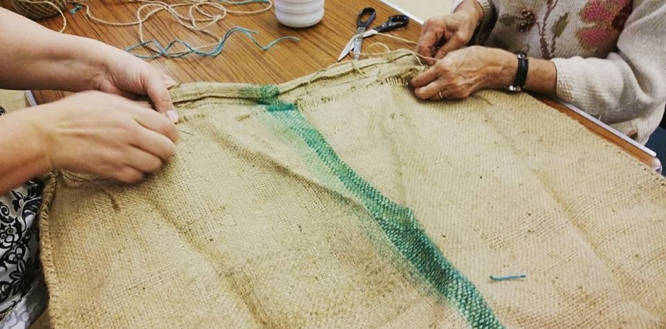 At Fearon Hall, sewing coffee sacks with Muto