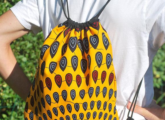 Sac à dos motif gouttes jaune bleu rouge