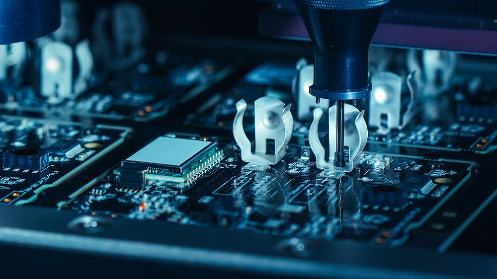 Electronic components being placed on a Printed Circuit by a Pick and Place machine