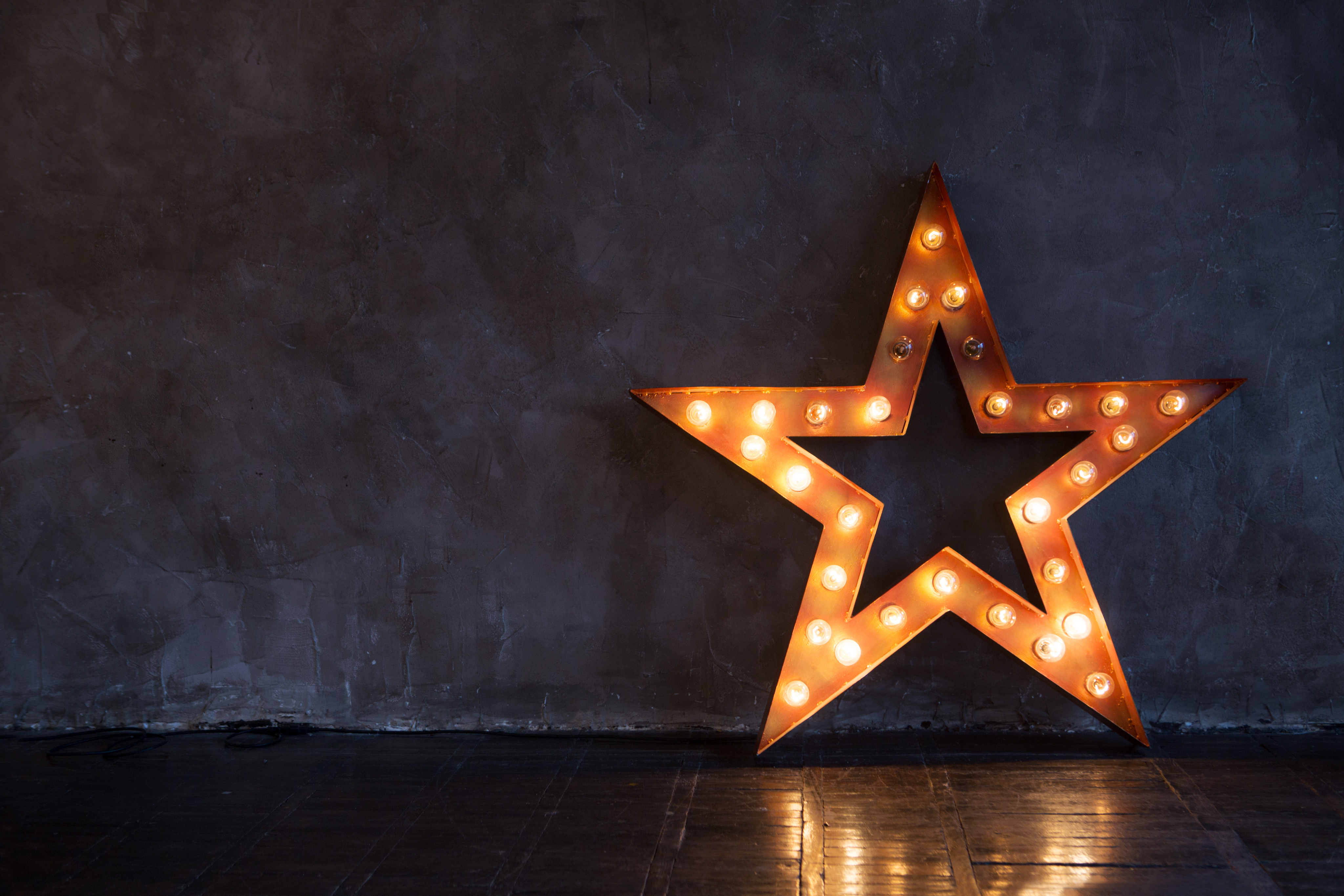 Decorative star with lamps on a background of wall