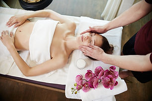 woman-enjoying-massage-in-spa-M8BV5UH.jp