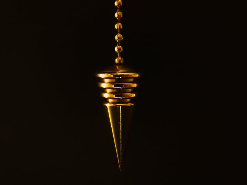 Hanging gold pendulum.