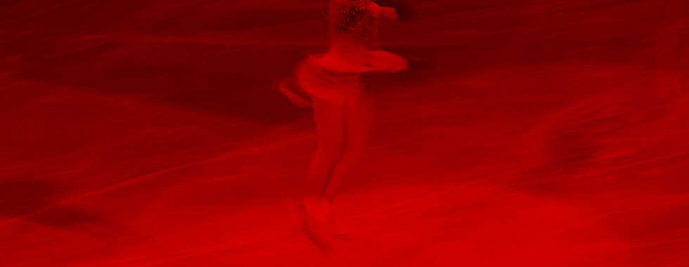 woman in beige performing ice skate_edited.jpg