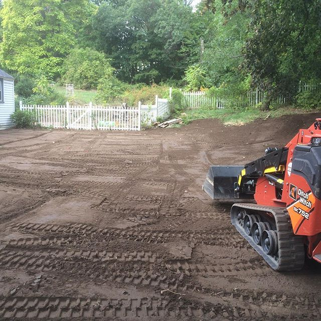 Spreading some dirt in #derrynh. Area was once a playground so we hauled out a few trucks of sand, a