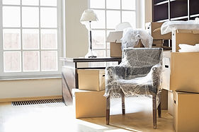 bigstock-Moving-boxes-and-furniture-in-1