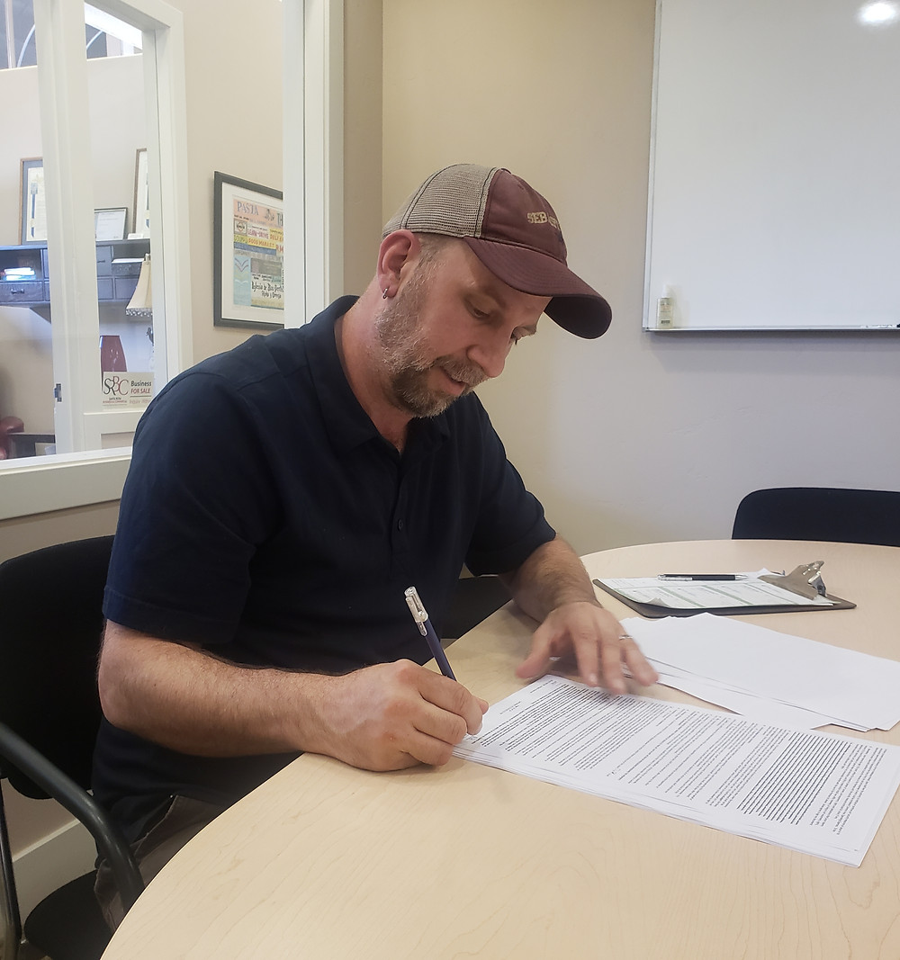 Chef Rob signing a new lease.