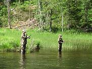 Fishing a stream in Michigan