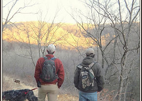 Sons hiking in Missouri with dogs