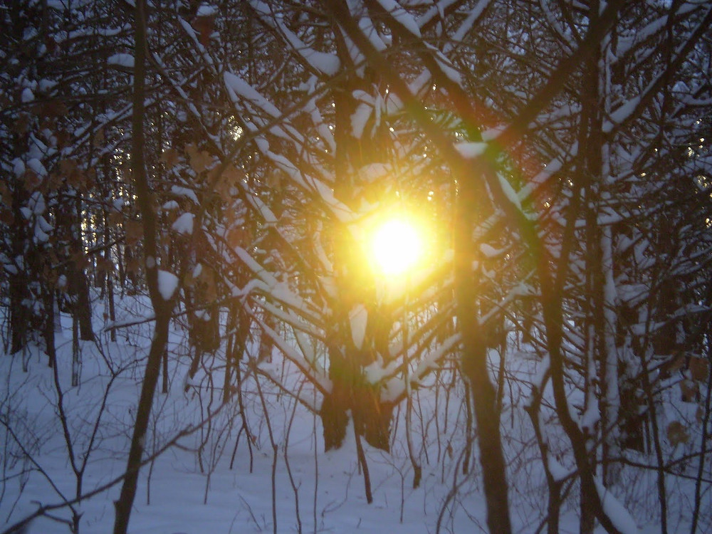 setting sun at end of winter hike