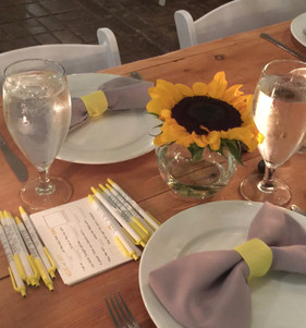 Personalized MadLib sheets and custom pens waited for guests at their table.